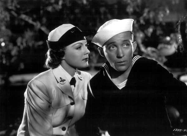 "A moment between Rosemary (Betty Hutton) and Johnny (Bing Crosby) in the film ""Here Come the WAVES."""