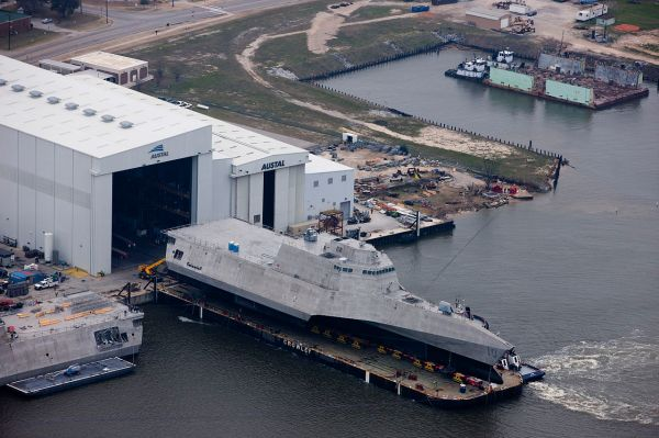An aerial view of the U.S. Navy littoral combat ship USS Gabrielle Giffords (LCS-10) during its launch sequence at the Austal USA shipyard, Mobile, Alabama (USA). US Navy Photograph